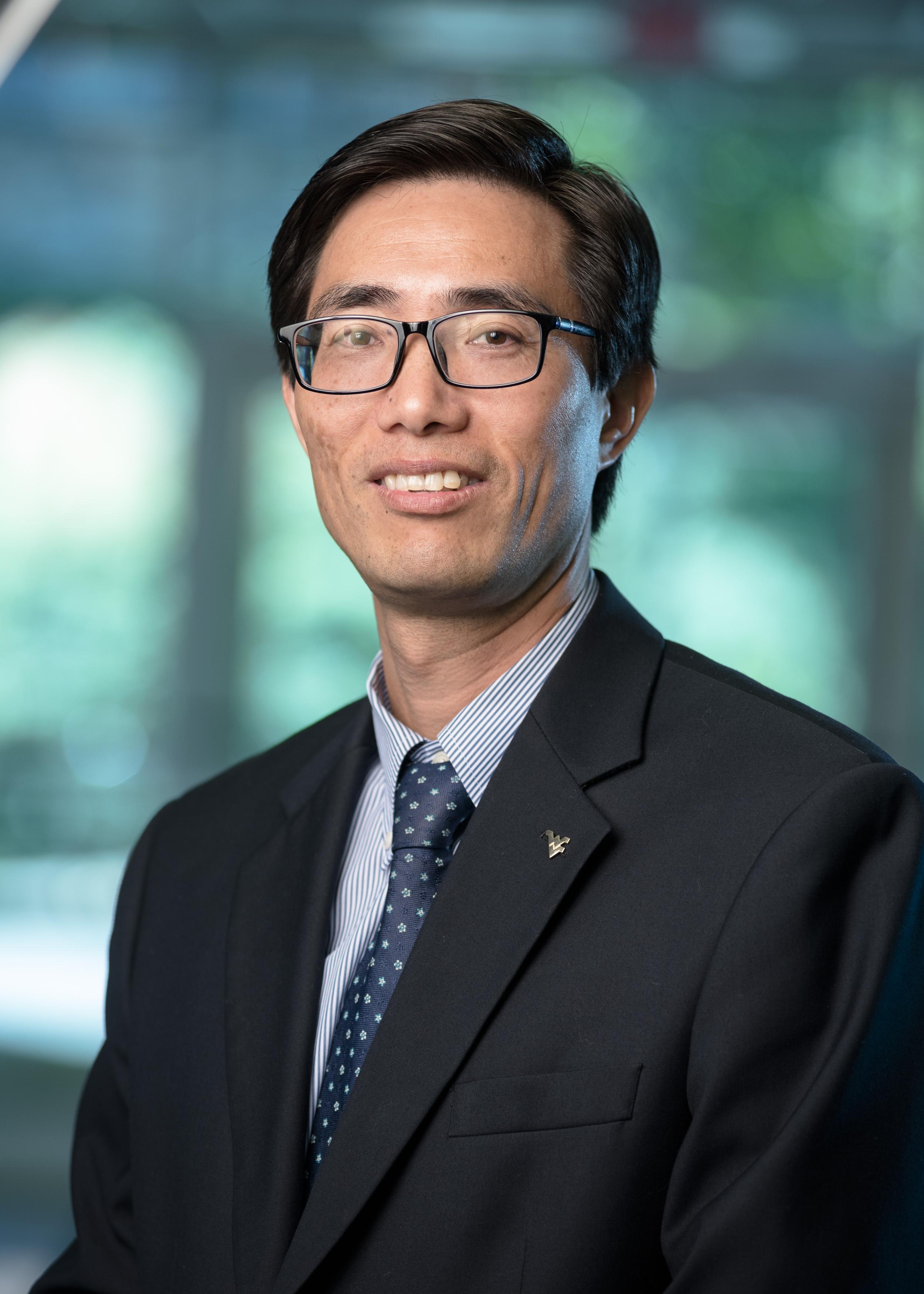 Zhongmin Zhao